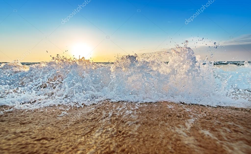 Inspiring and dynamic ocean bay sunrise on a secluded beach with