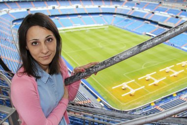 MADRID, SPAIN - SEPTEMBER 18: Girl on tour of Santiago Bernabeu stadium on September 18, 2014 in Madrid, Spain. Stadium was built in 1947, is named after mud Real Madrid president Santiago Bernabeu
