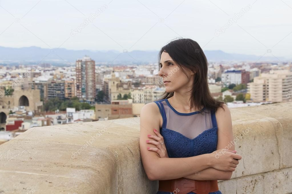 Beautiful caucasian girl and the view of Valencia