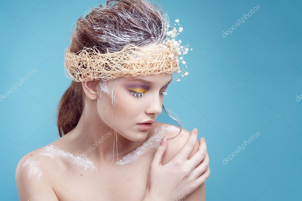 Winter beauty young woman portrait,model creative image with frozen makeup, with porcelain skin and long white lashes showing trendy, Ice-queen, Snow Queen, studio