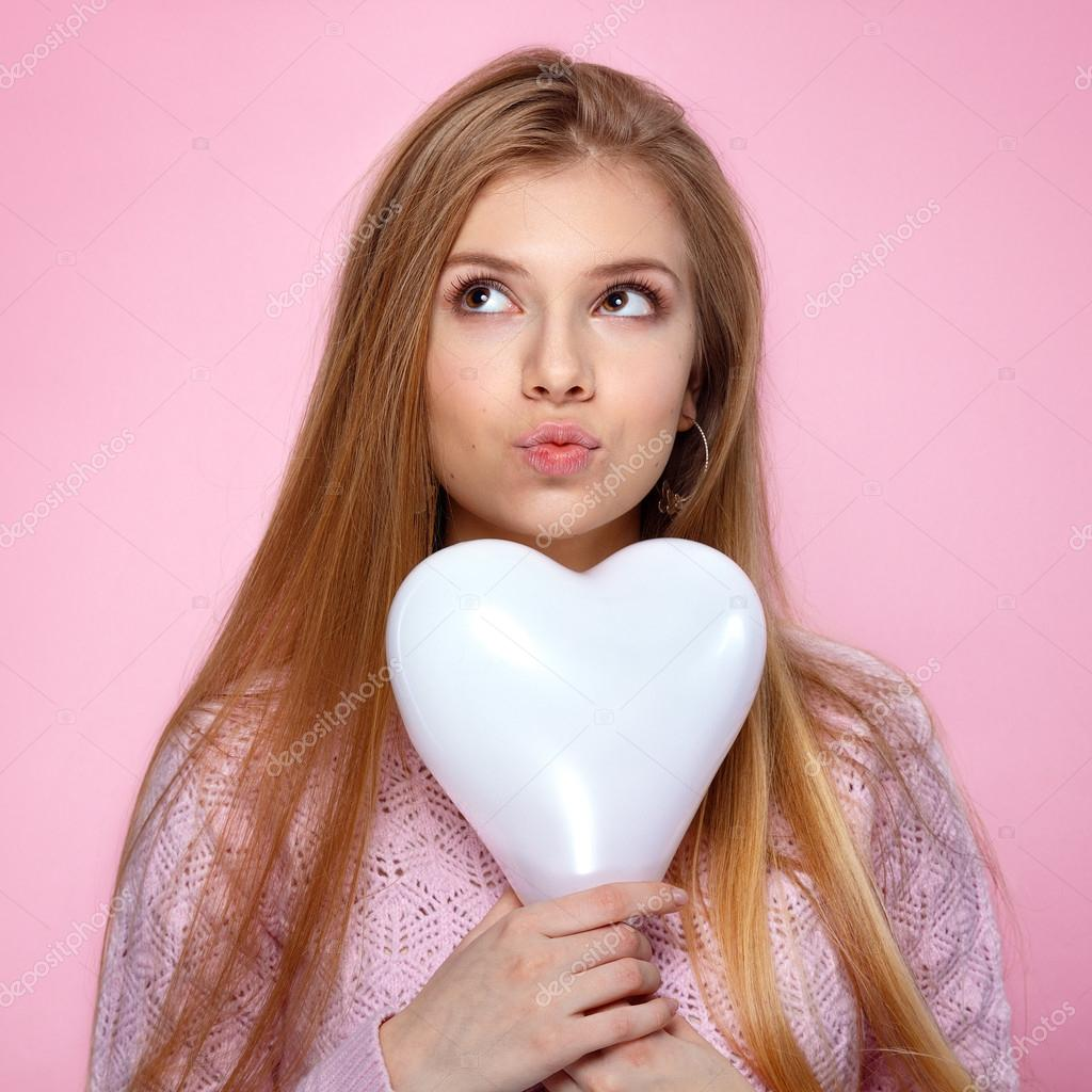 Sweet Blonde Woman Holding A Heartshaped Baloon Studio Portrait Over Pink Background Happy Birthday
