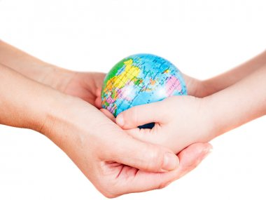 Hands of a child and a woman holding globe