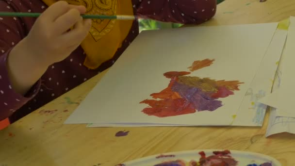 Child Painting with Tempera Paints