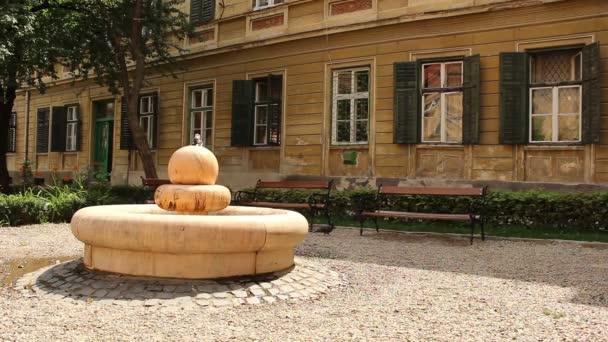 Fountain and Benches in a Baroque Garden