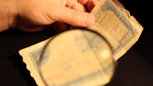 Specialist Inspect Old Banknote