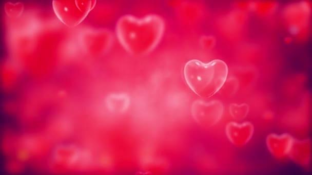 Animace srdce plovoucí a objevující se na červeném pozadí. - grafika
