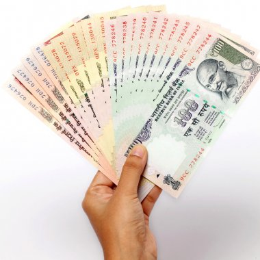 Hand holding Indian rupee notes