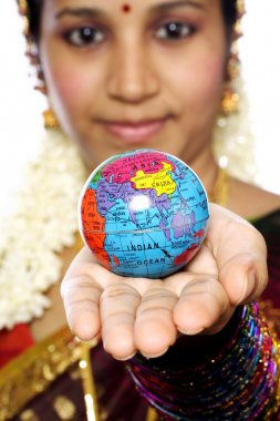 Traditional woman holding globe on her hand