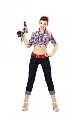 Rockabilly desperate housewife with cordless screwdriver, smiling and, ready for repair