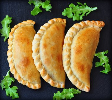 Mini calzone, closed pizza, Italian pastry stuffed with cheese and meat