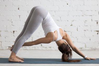 Yoga Indoors: Revolved Downward-facing dog pose
