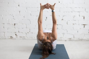 Yoga Indoors: warming up exercise