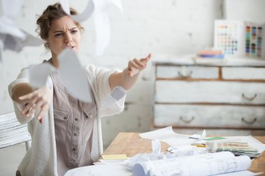 Young business woman in rage