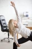 Fotografie Business woman doing yoga exercise