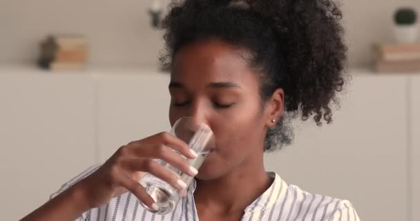 Close up of African woman drinking natural clean water