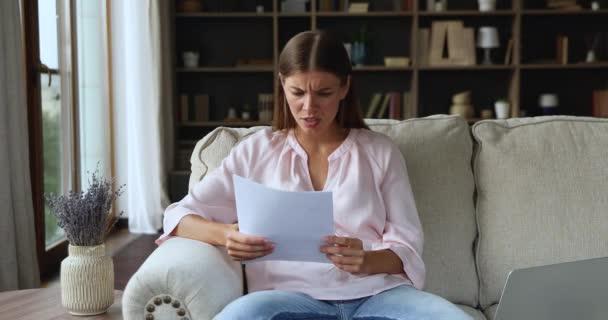 Worried nervous millennial female freelancer receive tax debt notification letter