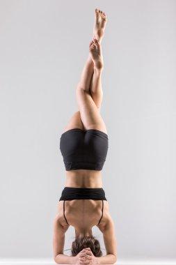 Yogi girl in headstand, asana Sirsasana, Shirshasana, Sirshasana