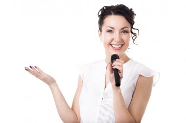 Young businesswoman announcer with microphone on white backgroun