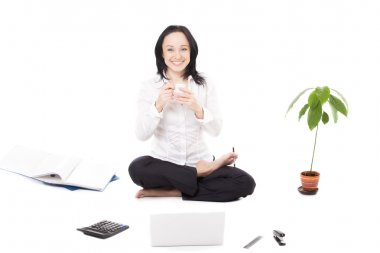 Young female company worker with laptop in lotus pose on white b