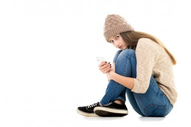 Difficult life situation, relationship problems, rebellious age. Teenage girl holding smartphone, waiting for call or message, looking anxious, copy space stock vector