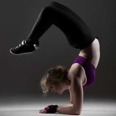 Beautiful sporty girl doing backbend on forearms