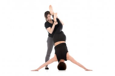 Yoga with coach, Iron Cross headstand