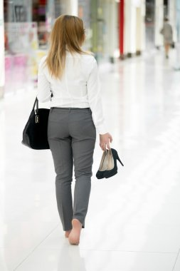 Walking barefoot in office style clothes