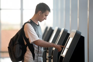Man doing self-registration for flight