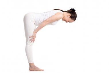 Yogi female standing in Half Forward Bend asana