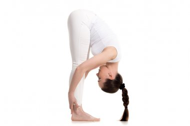Yogi female standing in Intense Forward-Bending Pose