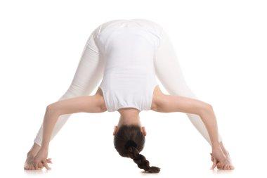 Yogi female standing in Wide Legged Forward Bend