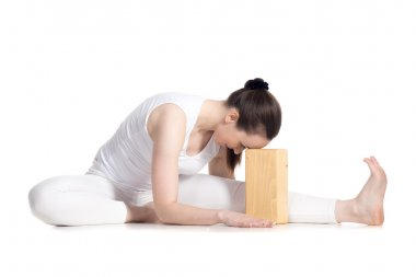 Yoga with props, Head to Knee forward bend yoga asana
