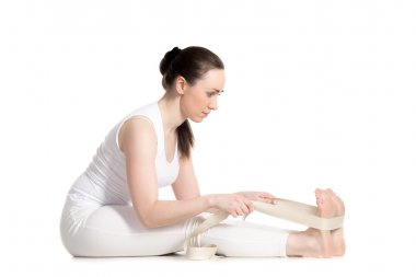 Yoga with props, seated forward bend pose