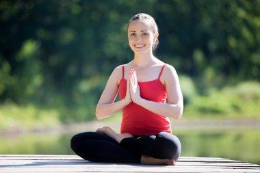 Yogi female in half lotus pose