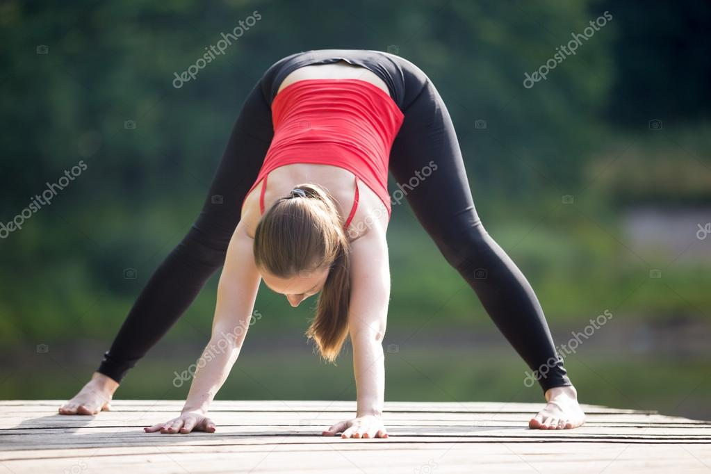 Teenage girl doing Wide Legged Forward Bend