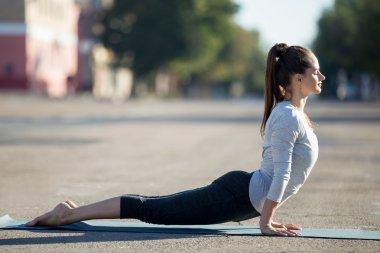 Street yoga: Upward facing dog pose