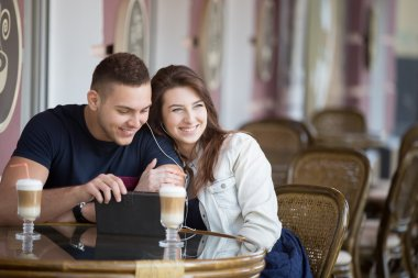 Couple flirting at a cafe