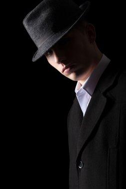 Portrait of handsome man in low key lighting