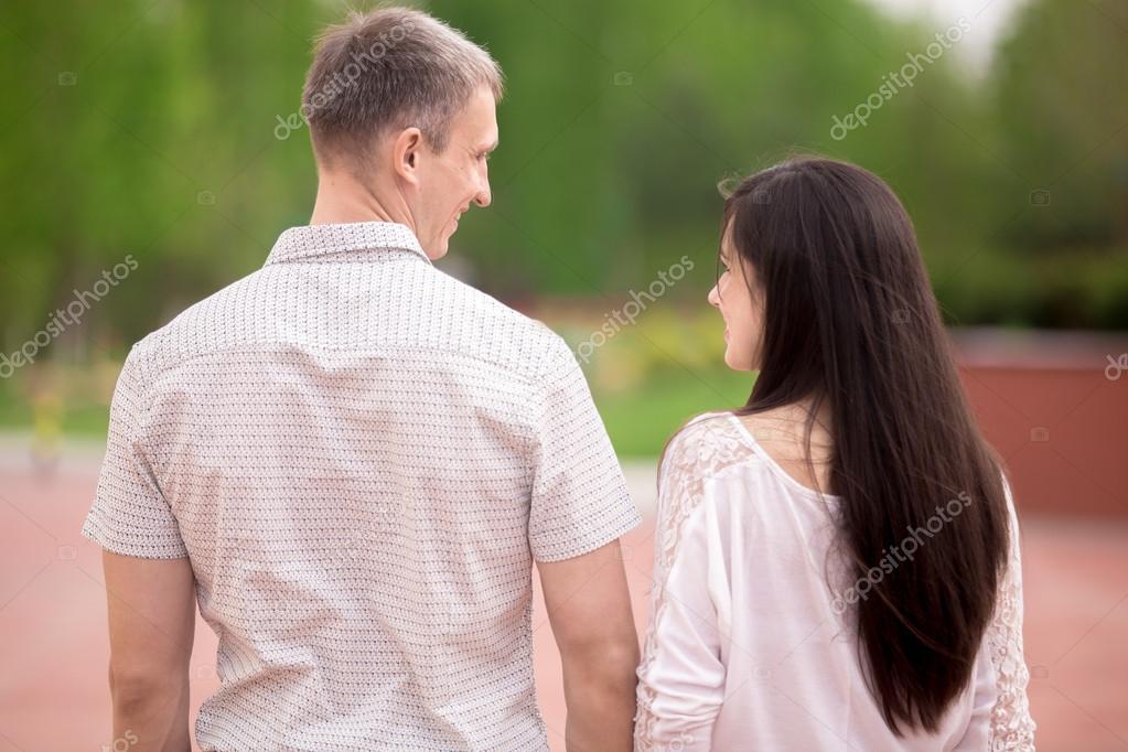 Couple walking, back view