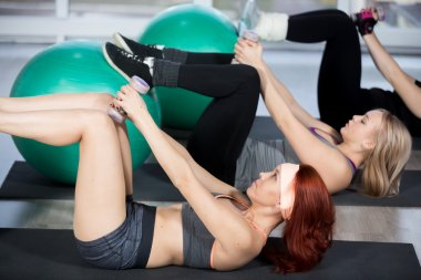 Exercises for abdomen on balls with dumbbells