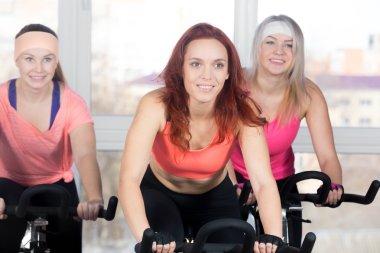 Group of women cycling in class