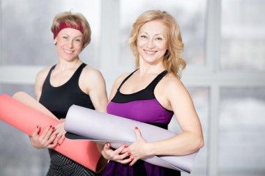 Portrait of two mature athletic women