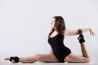Young woman doing splits
