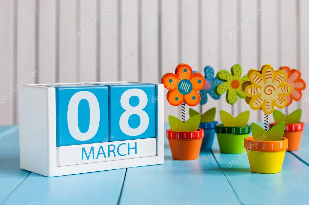 March 8th, save the date blue block calendar for International Womens Day, march 8, decorated with flower, vase