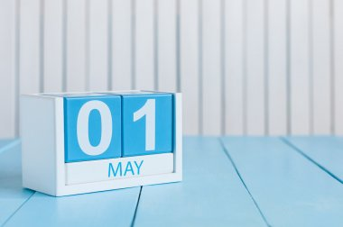 May 1st. Image of may 1 wooden color calendar on white background.  Spring day, empty space for text.  International Workers Day