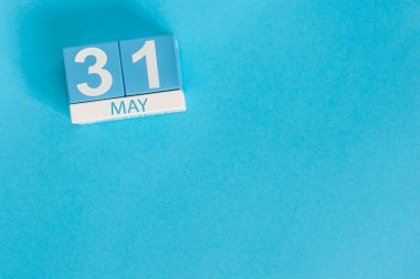 May 31st. Image of may 31 wooden color calendar on blue background.  Last spring day, Spring end. Empty space for text. World blondes Day