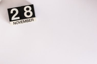 November 28th. Day 28 of month, wooden color calendar on white background. Autumn time. Empty space for text
