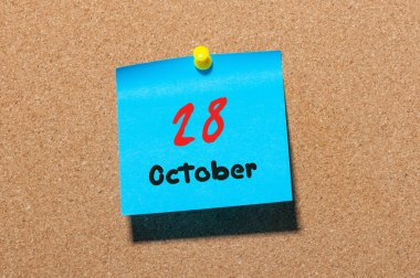 October 28th. Day 28 of month, color sticker calendar on notice board. Autumn time. Empty space for text