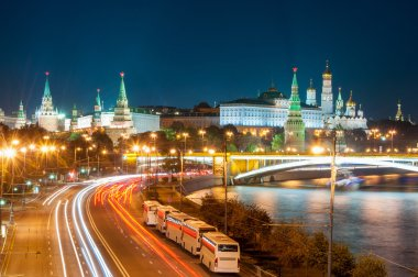 Evening in Moscow. Night view of the Kremlin and bridge illuminated by lights.