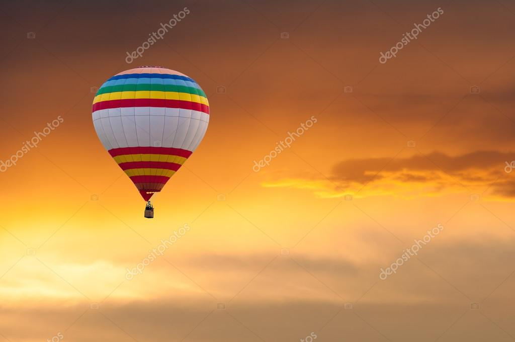 Hot Air Balloon in Flight on sunset sky background. Festival of colored balloons. Outdoor, Colorful